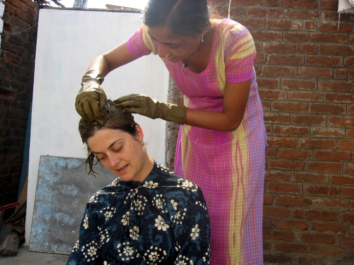 Traditional Indian women: One sister applies henna on my hair (2008)